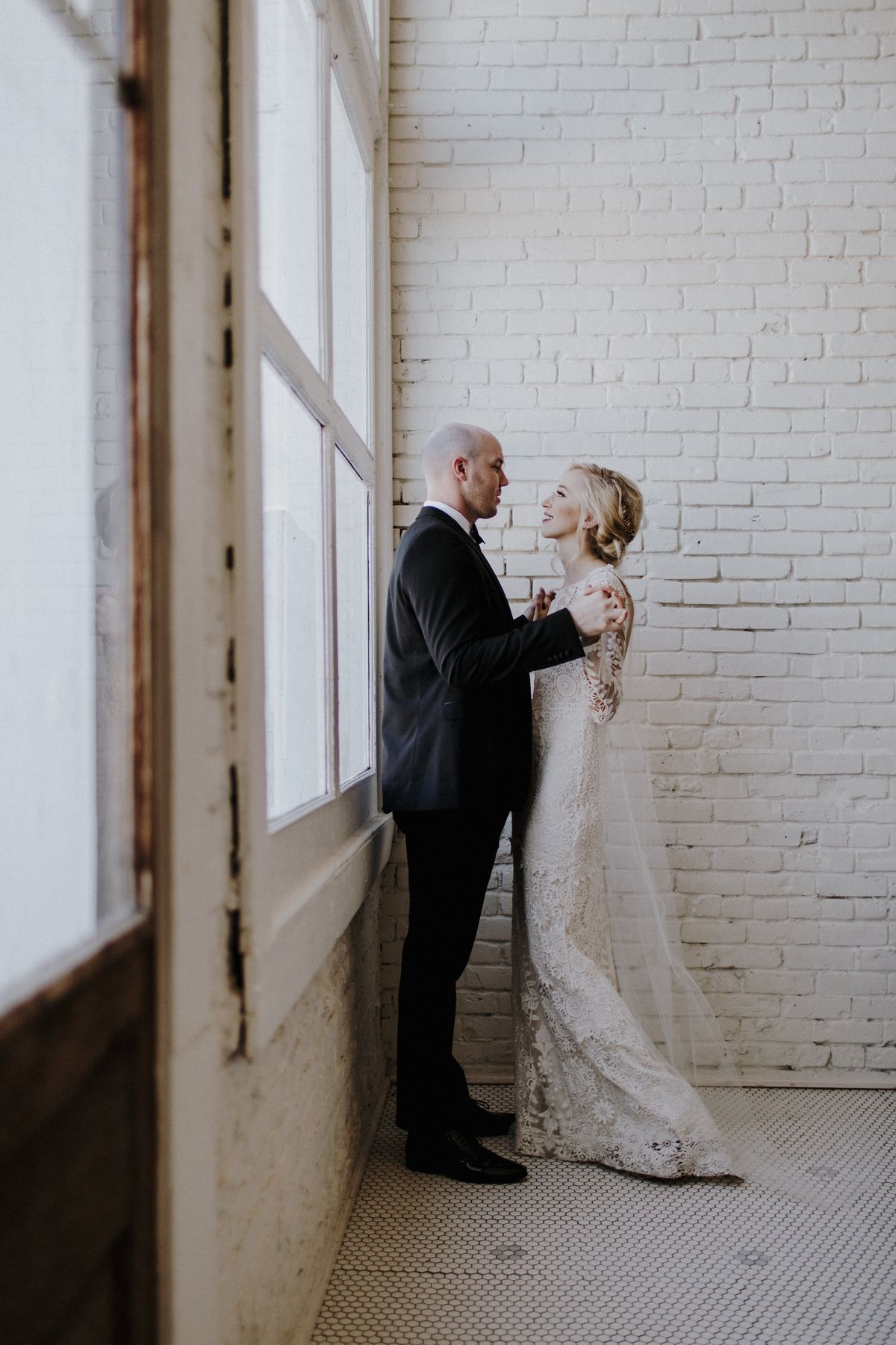 WhiteBrickWallLoftWedding.jpg