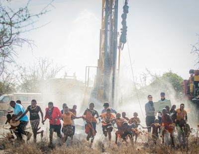 Salaita Kenya- Salaita project children running from drill water exploding Kristi Eric- November 2018.jpg