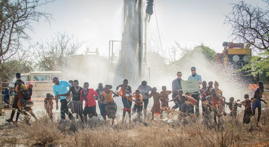 Salaita Kenya- Salaita project children running from drill water exploding Kristi Eric- November 2018 (1).jpg