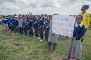 Copy of Njoguini- We are so grateful we now have clean water sign and school children- July 2019 (8 of 40).jpg