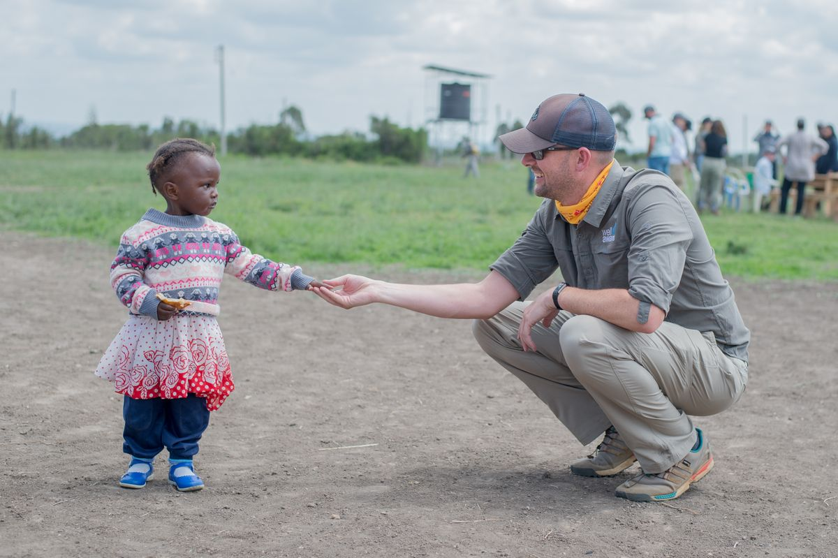 Copy of Njoguini- Eric Bailey holding hands with little girl- July 2019 (40 of 51).jpg