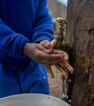 Njoguini- child washing hands with clean water from faucet- July 2019 (5 of 51).jpg