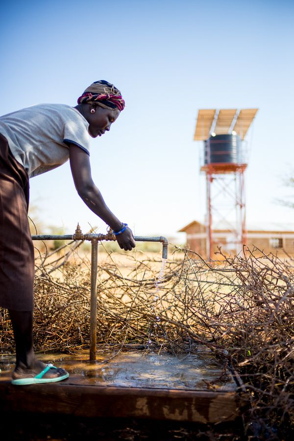 Kenya- Woman getting water from sprout- August 2014.jpg