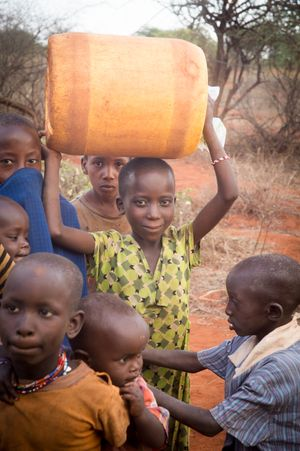 Salaita Kenya- girl holding water jug on head- November 2018.jpg