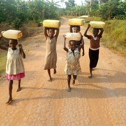 uganda kids carrying water 3 (1).jpg