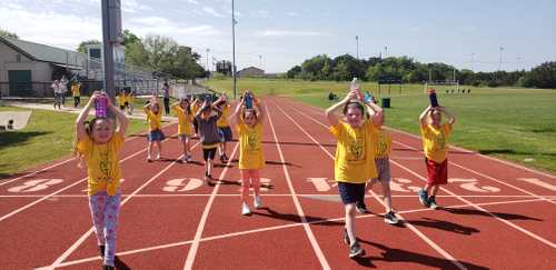 St. Gabes- children with water bottle on head on track- February 2019.jpg