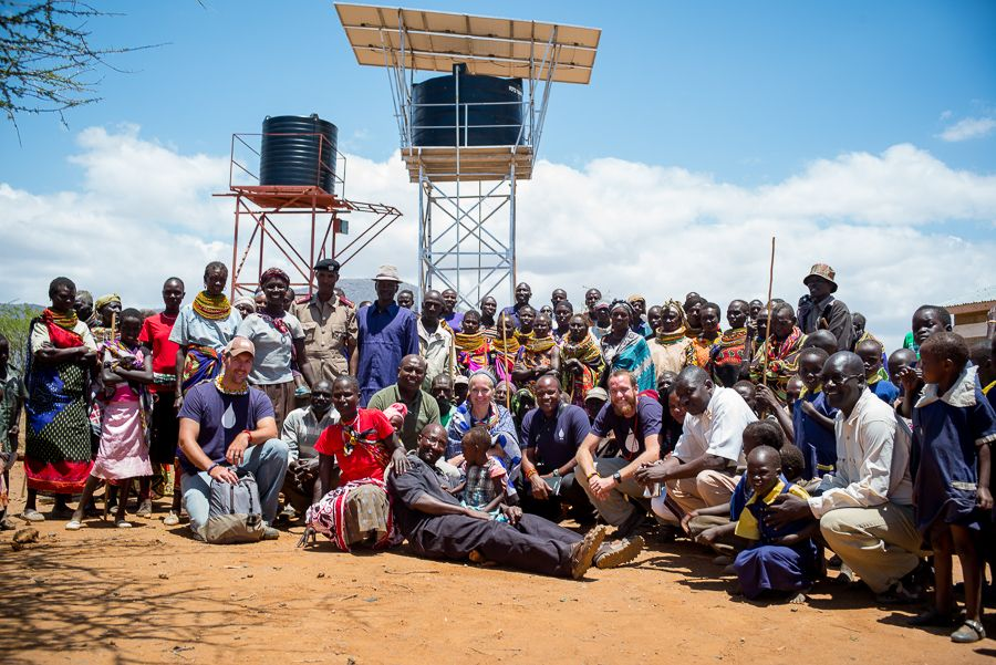 Kenya- community and team members and water tower- August 2014.jpg