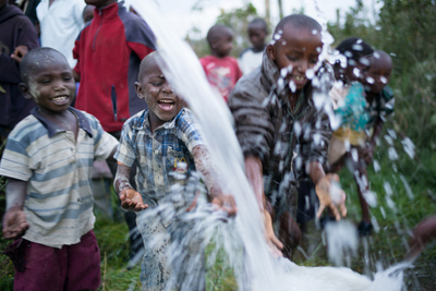 Bret%2FKenya%2F2014%2FKids play in water from new well.jpg