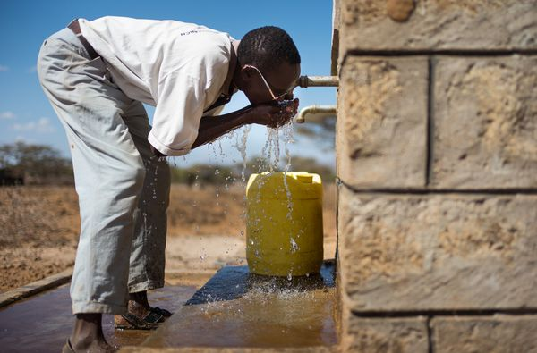 Man drinking clean water Kenya.jpg
