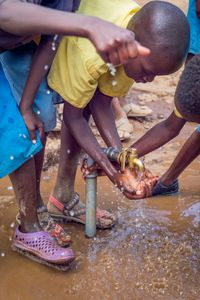 Daaba- schoolboy washing hands with clean water- Feb 2018.jpg