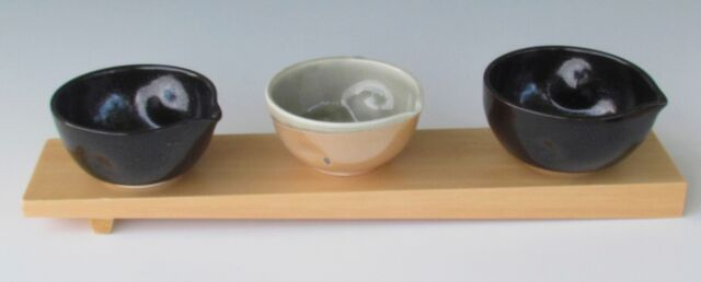 karen-hembree-pouring-bowl-trio-on-sushi-block-soda-fire-and-oxidation.jpg