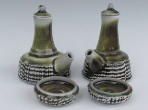 karen-hembree-tenmoku-ewer-set-with-bowls-soda-fire.jpg