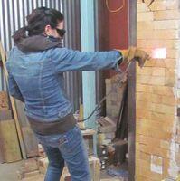 karen-hembree-underwood-center-spraying-soda-ash solution.jpg