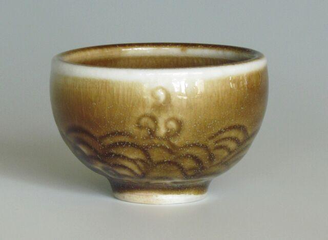 karen-hembree-amber-celadon-wave- carved-sake-cup-soda-fire.jpg