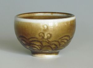 karen-hembree-amber-celadon-wave- carved-sake-cup-soda-fire.jpg