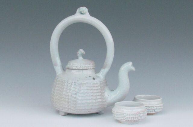 karen-hembree-nuka-glazed-teapot-and-bowls-soda-fire.jpg