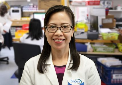 tien with pharmacy backdrop background small.jpg