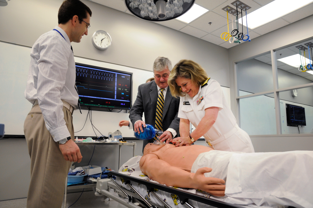Flickr_-_Official_U.S._Navy_Imagery_-_ear_Adm._Elizabeth_Niemyer_performs_CPR_on_a_medical_dummy..jpg