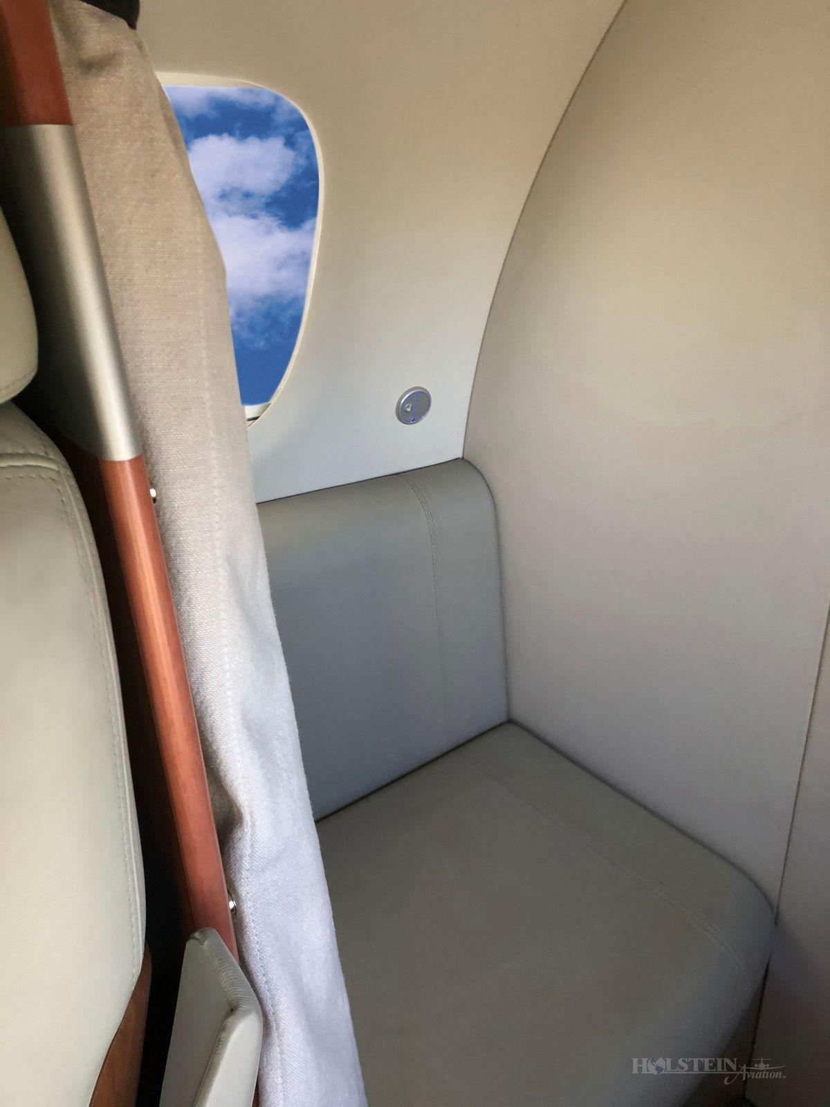 2011 Embraer Phenom 100 - 50000237 - N468ST - Int - Aft Seat RGB.jpg