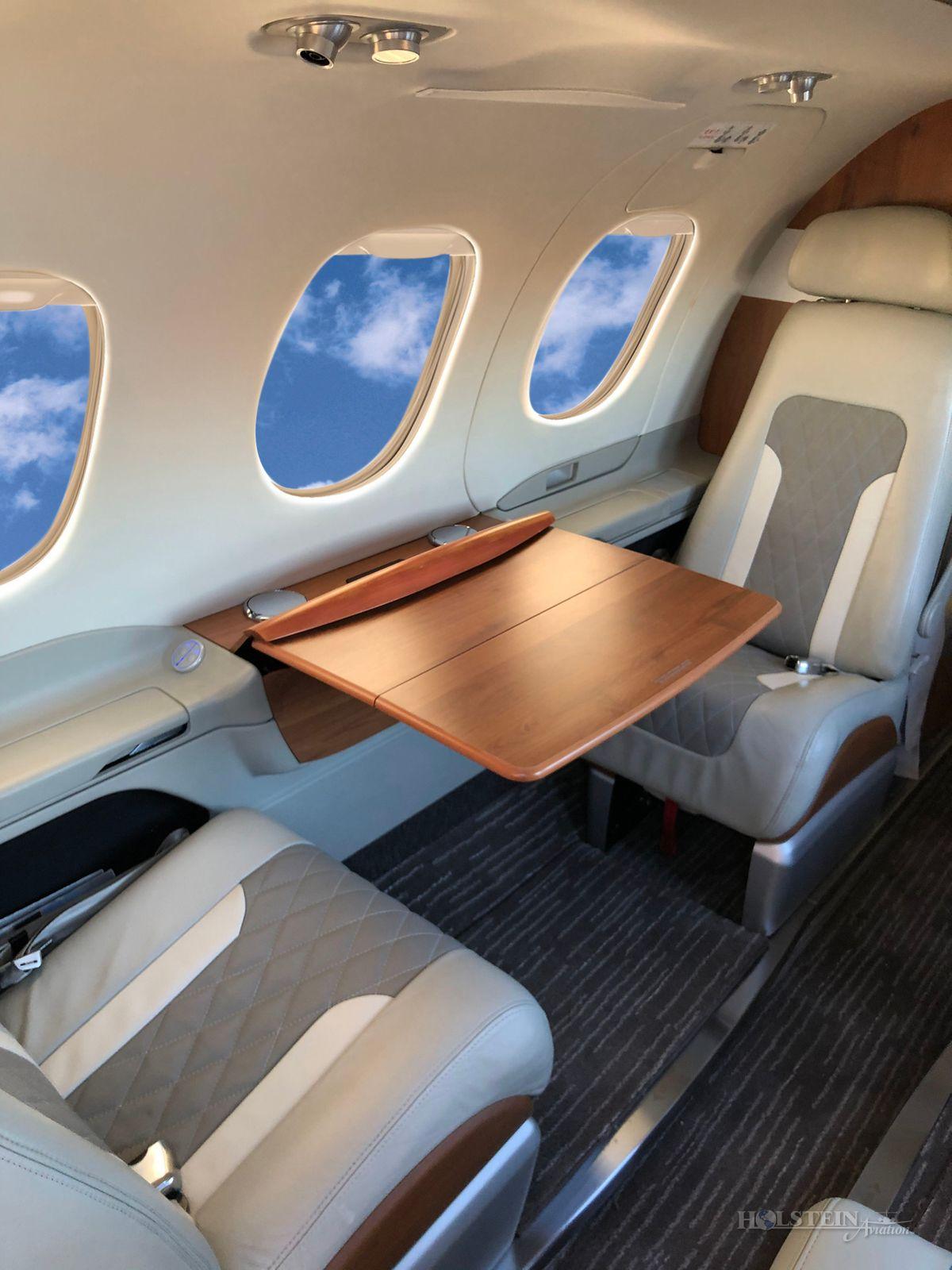 2011 Embraer Phenom 100 - 50000237 - N468St - Int - Tbl Ext RGB.jpg