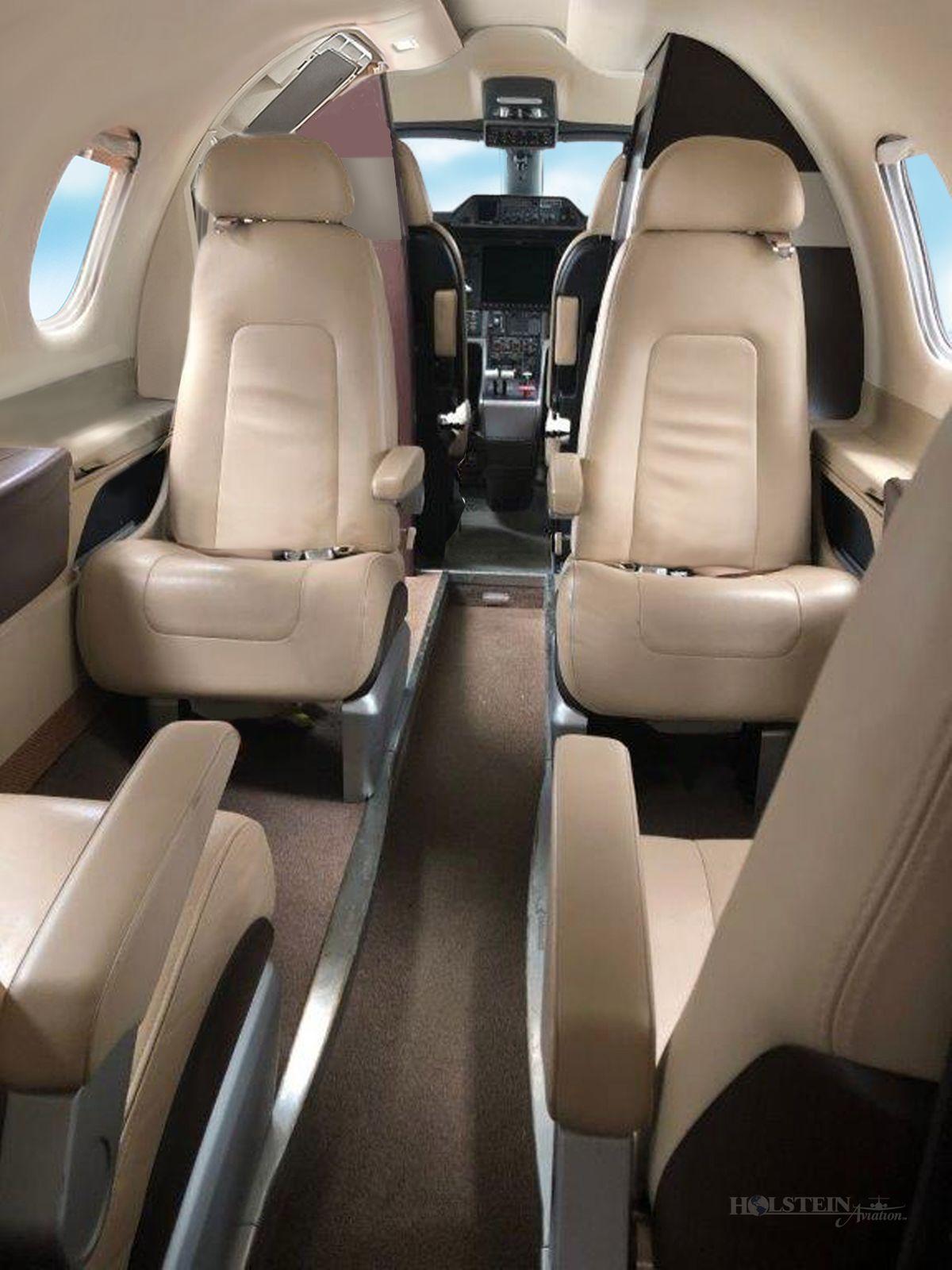 2013 Embraer Phenom 100 - SN 50000306 - VH-LWZ - Int - Aft Fac Fwd RGB.jpg