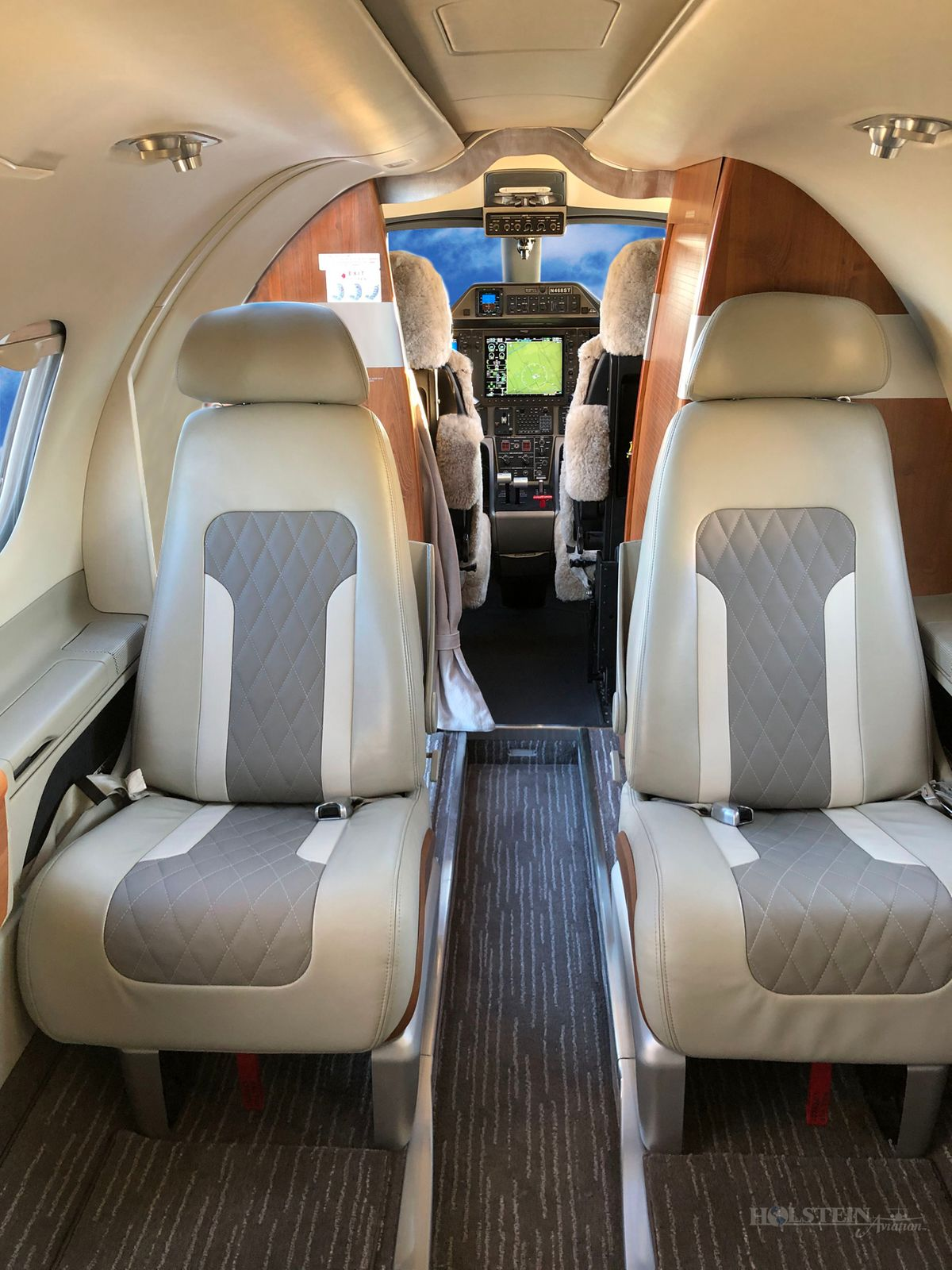 2011 Embraer Phenom 100 - 50000237 - N468ST - Int - Aft Fac Fwd RGB.jpg
