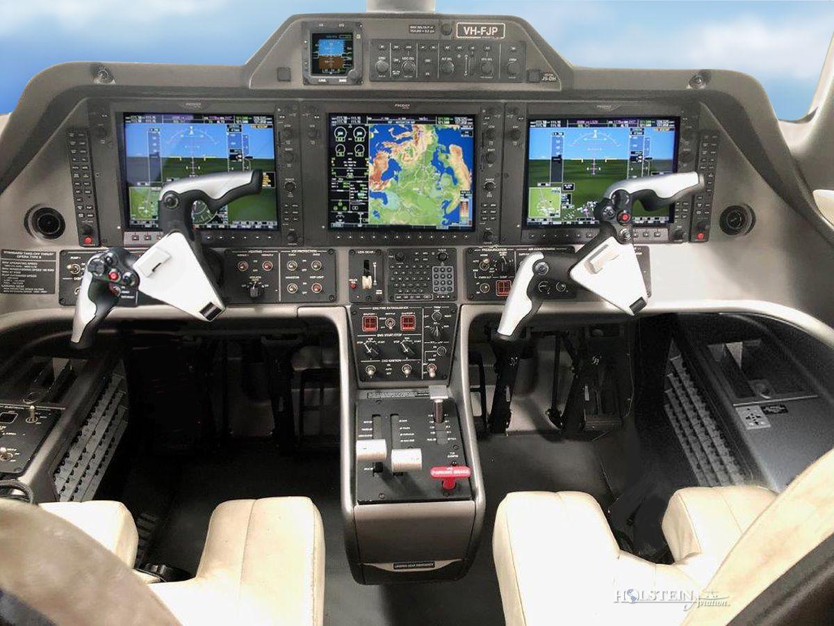 2011 Embraer Phenom 100 - SN 50000237 - VH-FJP - Cockpit RGB.jpg