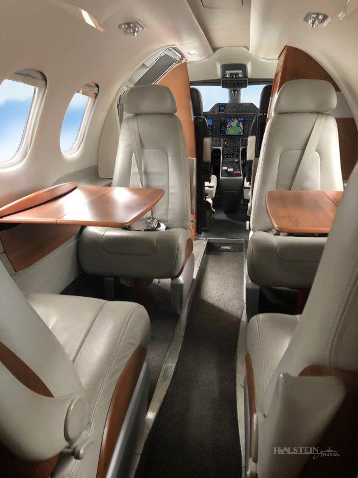 2011 Embraer Phenom 100 - SN 50000237 - VH-FJP - Int - Aft Fac Fwd - Tbl Ext RGB.jpg