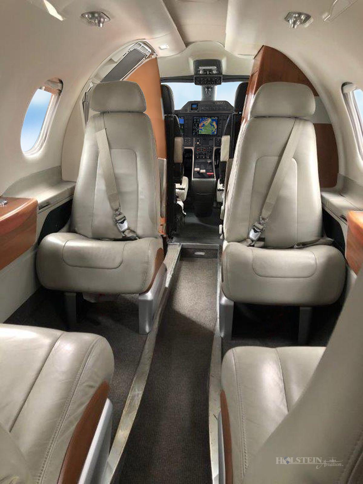 2011 Embraer Phenom 100 - SN 50000237 - VH-FJP - Int - Aft Fac Fwd RGB.jpg