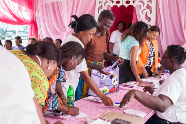 The first patient navigator in Nigeria helps women register for the Run For a Cure Africa free breast screening at Shoprite, Ikeja City Mall, Lagos. June 2016