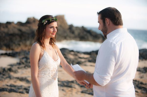 Wedding couple exchanging vows in Maui