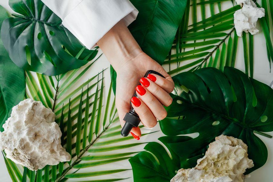 manicured-woman-s-nails-with-red-nail-polish-2021-05-11-01-37-10-utc.jpg
