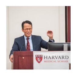Dr Kang giving a lecture at Harvard Medical School.jpg