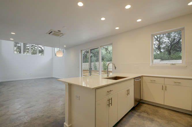 1208 Woodland Unit A-small-013-30-Kitchen and Breakfast 404-666x442-72dpi.jpg