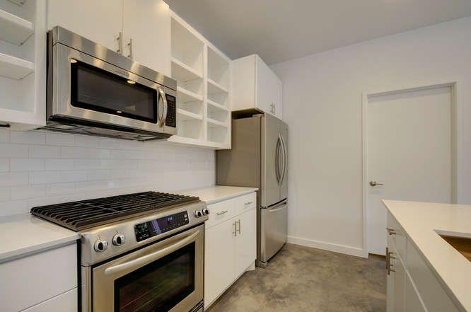 1208 Woodland Unit A-small-014-23-Kitchen and Breakfast 406-666x442-72dpi.jpg