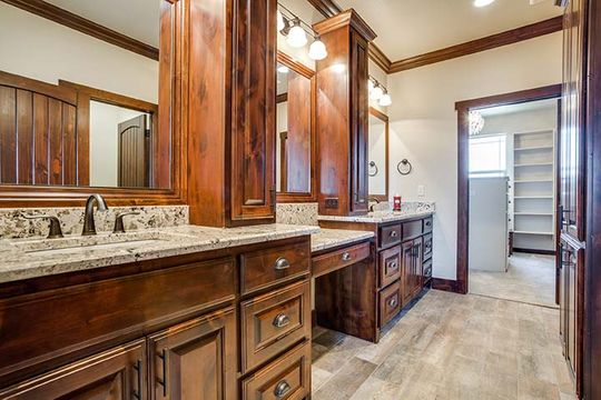 Custom Stained Cabinetry in Luxury Bathroom