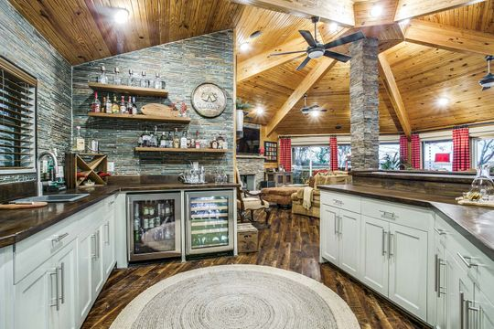 Custom Home and Gourmet Kitchen with Custom Stone and Wood Finish