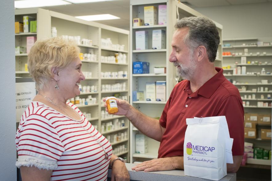 Pharmacist describing medication to patient