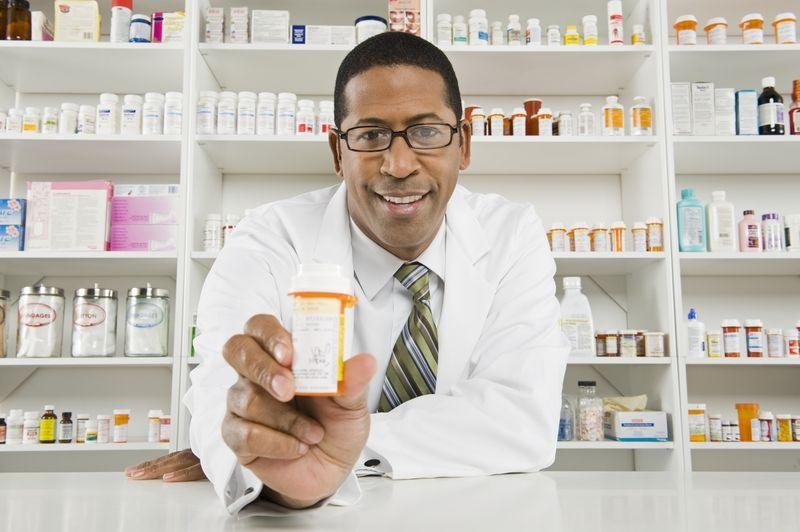 pharmacist handing bottle.jpg