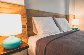 Tiny House With Rustic Shiplap Headboard