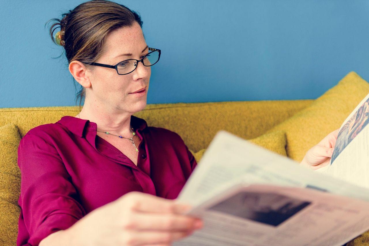 caucasian-woman-reading-the-newspaper-PJKPLHB.jpg