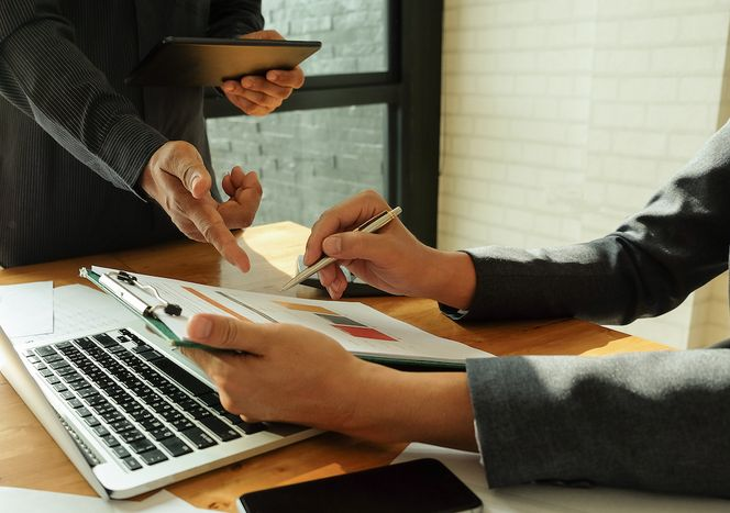 business-team-analyzes-the-data-from-the-graphs-GA5JCD4.jpg