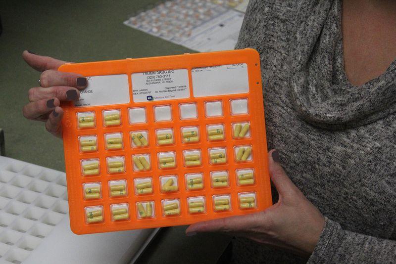 Tina with MOT Card.jpg