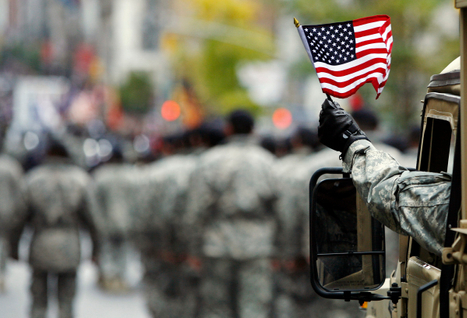 us-armed-serviceman-waves-american-flag-during-veterans-day-parade-in-new-york.jpg