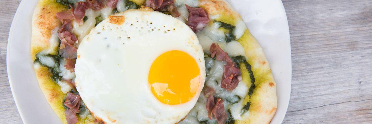 NAAN BREAKFAST FLAT BREAD | fried egg, peso, prosciutto, provolone, arugula