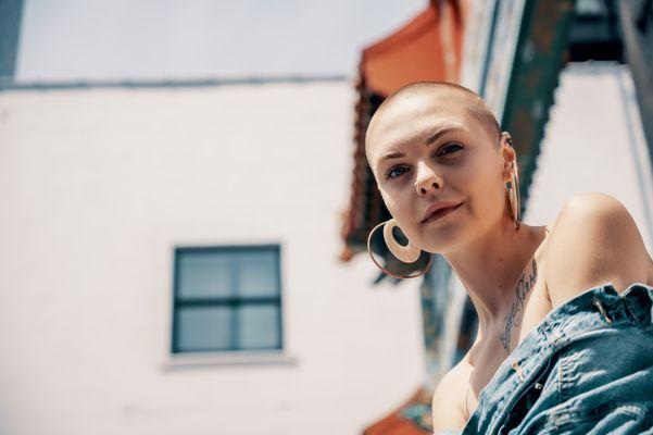 bald-beautiful-woman-denim-jacket-2480096.jpg