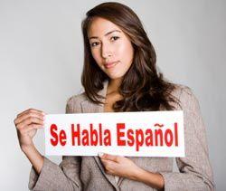Spanish-speaker-with-sign.jpg