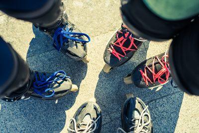 top-view-of-feet-of-friends-roller-skaters-TWUMT37.jpg