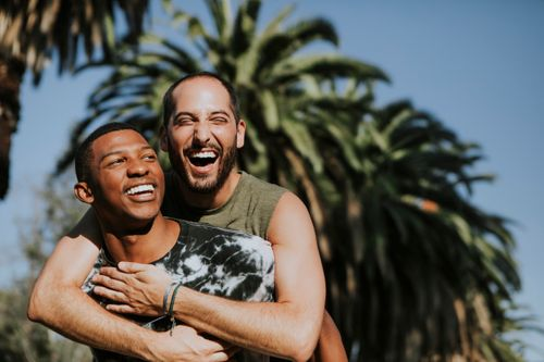 gay-couple-hugging-in-the-park-2021-04-02-19-57-31-utc.jpg