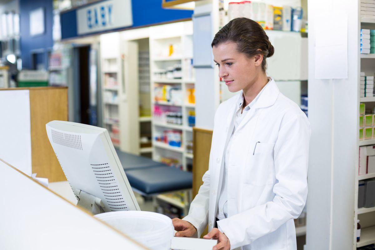 pharmacist-making-prescription-record-through-comp-2U4CVXT-min.jpg